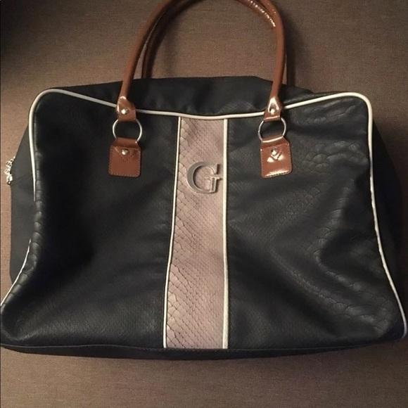 Guess Handbags - Guess snakeskin overnight bag cb0f637d8f706